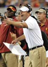 Southern California coach Lane Kiffin gestures during the third quarter of an NCAA college football game against Syracuse on Saturday, Sept. 8, 2012, in East Rutherford, N.J. USC defeated Syracuse 42-29. (AP Photo/Bill Kostroun)