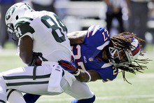 Buffalo Bills cornerback Stephon Gilmore, right, tackles New York Jets wide receiver Stephen Hill during the first half of an NFL football game at MetLife Stadium, Sunday, Sept. 9, 2012, in East Rutherford, N.J. (AP Photo/Bill Kostroun)
