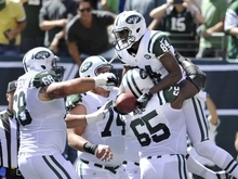 New York Jets wide receiver Stephen Hill (84) celebrates with teammates Matt Slauson (68) and Brandon Moore after scoring a touchdown during the first half of an NFL football game against the Buffalo Bills at MetLife Stadium, Sunday, Sept. 9, 2012, in East Rutherford, N.J. (AP Photo/Bill Kostroun)
