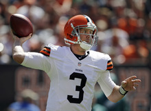Cleveland Browns quarterback Brandon Weeden passes against the Philadelphia Eagles in the first quarter of an NFL football game on Sunday, Sept. 9, 2012, in Cleveland. (AP Photo/Mark Duncan)