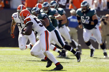 Cleveland Browns linebacker D'Qwell Jackson, front, runs toward the end zone after making an interception in the fourth quarter of an NFL football game against the Philadelphia Eagles, Sunday, Sept. 9, 2012, in Cleveland. Jackson ran for a 27-yard touchdown. (AP Photo/Ron Schwane)