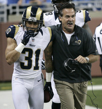 St. Louis Rams defensive back Cortland Finnegan (31) celebrates his interception and 31-yard return for a touchdown with coach Jeff Fisher in the second quarter of an NFL football game against the Detroit Lions, Sunday, Sept. 9, 2012, in Detroit. (AP Photo/Duane Burleson)