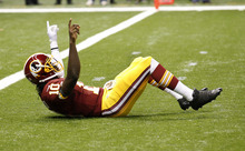 Bill Haber | The Associated Press Washington's Robert Griffin III celebrates after throwing a touchdown against the Saints. Of the five rookie quarterbacks making their NFL regular-season debut Sunday, Griffin was the only one to come away with a victory.