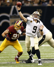New Orleans Saints quarterback Drew Brees (9) passes in the first half of an NFL football game against the Washington Redskins at Mercedes-Benz Superdome in New Orleans, Sunday, Sept. 9, 2012. (AP Photo/Bill Haber)