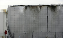 Francisco Kjolseth  |  The Salt Lake Tribune A cracked top on a Woods Cross refinery storage tank spread an unspecified amount of thick oil overnight, coating businesses east of the Holly Oil Refinery in a black spray that could take days to clean up.