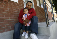 Francisco Kjolseth  |  The Salt Lake Tribune Ernesto Perez, who turns 21 next month, spends time with his son Dominique, 2, at their home in Salt Lake. Ernesto is a success story of Stand a Little Taller (SALT) program, an anti-gang program in SLC that helps young men stay away from gang life and move towards being successful. Perez has been involved in sports programs and or structured SALT activities in the past that has helped him steer a better course in life.