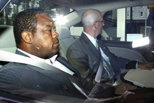 Trenton Mayor Tony Mack, left, is driven in custody into the federal courthouse in Trenton, N.J., Monday, Sept. 10, 2012, after agents arrested him earlier Monday as part of an ongoing corruption investigation into bribery allegations related to a parking garage project that was concocted as part of an FBI sting operation. (AP Photo/Mel Evans)