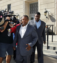 Trenton Mayor Tony Mack and his brother Ralphiel Mack, right, leave the Federal courthouse Monday, Sept. 10, 2012, in Trenton, N.J., after a federal magistrate ordered Mack released on an unsecured $150,000 bond but ruled that he cannot leave the state while free on bail. Earlier Monday, Federal agents arrested Mack, the mayor of New Jersey's capital city, his brother, Ralphiel, and convicted sex offender Joseph Giorgianni, a Mack supporter who owns a Trenton sandwich shop, as part of an ongoing corruption investigation into bribery allegations related to a parking garage project that was concocted as part of an FBI sting operation. (AP Photo/Mel Evans)