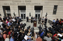 U.S. Attorney Paul Fishman, center, at podium, stands with other law enforcement officials outside the Federal courthouse Monday, Sept. 10, 2012, in Trenton, N.J., as he announces that Federal agents arrested Trenton Mayor Tony Mack, the mayor of New Jersey's capital city, earlier Monday as part of an ongoing corruption investigation into bribery allegations related to a parking garage project that was concocted as part of an FBI sting operation. Mack, his brother, Ralphiel, and convicted sex offender Joseph Giorgianni, a Mack supporter who owns a Trenton sandwich shop, were accused of conspiring to obstruct, delay and affect interstate commerce by extortion under color of official right. (AP Photo/Mel Evans)