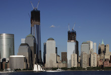 FILE - In this file photo of June 23, 2012, construction cranes perch on top of One World Trade Center, left, and Four World Trade Center in New York. Eleven years after terrorists attacked the World Trade Center, the new World Trade Center now dominates the lower Manhattan skyline. (AP Photo/Mark Lennihan, File)