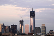 One World Trade Center, is now up to 104 floors, rises above the lower Manhattan skyline, Thursday, Sept. 6, 2012 in New York. Tuesday will mark the eleventh anniversary of the terrorist attacks of Sept. 11, 2001. Also under construction is 4 World Trade Center, center left. (AP Photo/Mark Lennihan)