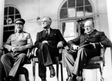 FILE - In this Nov. 28, 1943 file photo, Soviet Union Premier Josef Stalin, U.S. President Franklin D. Roosevelt, center, and British Prime Minister Winston Churchill sit together during the Tehran Conference in Tehran, Iran. The three leaders, meeting for the first time, discussed Allied plans for the war against Germany and for postwar cooperation in the United Nations. Two American POWs sent secret coded messages to Washington with news of a Soviet atrocity: In 1943 they saw rows of corpses in an advanced state of decay in the Katyn forest, on the western edge of Russia, proof that the killers could not have been the Nazis who had only recently occupied the area. The testimony about the infamous massacre of Polish officers might have lessened the tragic fate that befell Poland under the Soviets, some scholars believe. Instead, it mysteriously vanished into the heart of American power. The long-held suspicion is that President Franklin Delano Roosevelt didn't want to anger Josef Stalin, an ally whom the Americans were counting on to defeat Germany and Japan during World War II. (AP Photo)