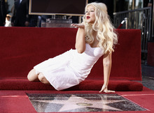 Singer and actress Christina Aguilera poses after she received a star on the Hollywood Walk of Fame in Los Angeles, Monday, Nov. 15, 2010.  (AP Photo/Matt Sayles)