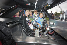 Paul Fraughton | Salt Lake Tribune  Youngsters peek inside a dragster on display at  Silver Hills Elementary School in Kearns. Race cars and drivers from Rocky Mountain Raceway  brought their  race cars to the school so kids could get an up close experience with the unique machines.The event was sponsored by the school's PTA.  Monday, September 10, 2012