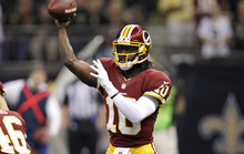 Washington Redskins quarterback Robert Griffin III (10) passes in the first half of an NFL football game at the Mercedes-Benz Superdome in New Orleans, Sunday, Sept. 9, 2012. (AP Photo/Gerald Herbert)