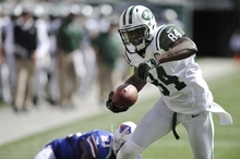 New York Jets wide receiver Stephen Hill runs for a touchdown against the Buffalo Bills during the second half of an NFL football game at MetLife Stadium Sunday, Sept. 9, 2012, in East Rutherford, N.J. (AP Photo/Bill Kostroun)