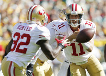 San Francisco 49ers quarterback Alex Smith pitches the ball during the first half of an NFL football game against the Green Bay Packers Sunday, Sept. 9, 2012, in Green Bay, Wis. (AP Photo/Mike Roemer)