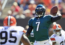 Philadelphia Eagles quarterback Michael Vick (7) looks for a receiver during an NFL football game against the Cleveland Browns Sunday, Sept. 9, 2012, in Cleveland. (AP Photo/Tony Dejak)