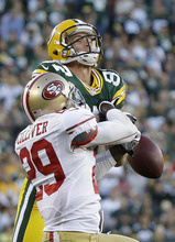 Morry Gash | The Associated Press San Francisco's Chris Culliver, left, breaks up a pass intended for Green Bay's Jordy Nelson.