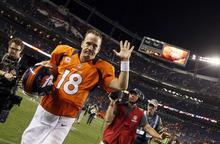 Denver Broncos quarterback Peyton Manning waves to the crowd as he leaves the field following an NFL football game against the Pittsburgh Steelers, Sunday, Sept. 9, 2012, in Denver. The Broncos won 31-19. (AP Photo/David Zalubowski)