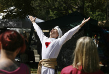 Scott Sommerdorf  |  The Salt Lake Tribune              Matthew Szymanski takes part in a ceremony evoking the God Horus, during the Annual Pagan Pride Day at Murray Park, Sunday, September 9, 2012.
