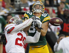 San Francisco 49ers' Chris Culliver (29) breaks up a pass intended for Green Bay Packers' Jordy Nelson during the second half of an NFL football game Monday, Sept. 10, 2012, in Green Bay, Wis. The 49ers won 30-22. (AP Photo/Mike Roemer)