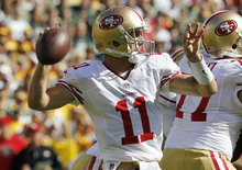 San Francisco 49ers' Alex Smith throws during the first half of an NFL football game against the Green Bay Packers Sunday, Sept. 9, 2012, in Green Bay, Wis. (AP Photo/Mike Roemer)