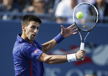 Serbia's Novak Djokovic returns a shot to Britain's Andy Murray during the championship match at the 2012 US Open tennis tournament,  Monday, Sept. 10, 2012, in New York. (AP Photo/Charles Krupa)