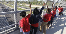 Chicago public school teachers walk a picket line on an overpass on the Dan Ryan expressway near Shoop Elementary School in Chicago, Tuesday, Sept. 11, 2012, on the second day of a strike in the nation's third-largest school district as negotiations by the two sides failed to reach an agreement Monday in a bitter contract dispute over evaluations and job security. (AP Photo/M. Spencer Green)