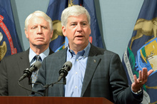 In a handout photo from the state's governors office, Gov. Rick Snyder announces sweeping changes to how Michigan's largest health insurance provider is regulated during a press conference in Lansing, Mich., Tues. Sept. 11. 2012. Snyder called for Blue Cross to become a nonprofit mutual insurance company that is regulated under the Michigan Insurance Code like all other health insurers in the state. State Department of Community Health Director Jim Haveman, left, and other officials were on hand for the announcement. (AP Photo/Michigan Governor's Office, HO)