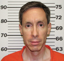 File - In this Nov. 26, 2007, file photo released by the Utah Department of Corrections shows convicted polygamous-sect leader Warren Jeffs, in Draper, Utah. Attorneys defending a polygamous town on the Utah-Arizona border against allegations of civil rights violations want a change of venue. A lawsuit filed by the U.S. Department of Justice in June claims that officials in Hildale, Utah, and Colorado City have supported a campaign of intimidation against former members of the Fundamentalist Church of Jesus Christ of Latter Day Saints and denied them services. Residents of both communities largely are made up of members of the FLDS, run by jailed leader Warren Jeffs. (AP Photo/Utah Dept. of Corrections, HO, File)