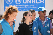 The U.N. refugee agency's special envoy, actress Angelina Jolie, center, arrives to the Zaatari Refugees Camp in Jordan for Syrians who fled the civil war in their country, Tuesday, Sept. 11, 2012. Jolie said Tuesday she heard