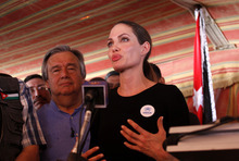 The U.N. refugee agency's special envoy, actress Angelina Jolie, center, speaks to the press at the Zaatari Refugees Camp in Jordan for Syrians who fled the civil war in their country, Tuesday, Sept. 11, 2012. Jolie said Tuesday she heard