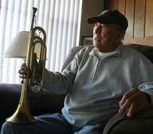 Steve Griffin |  The Salt Lake Tribune George Murakami holds the bugle he played as a young man in Topaz, the internment camp for Japanese Americans northwest of Delta, from his home in Rose Park, Utah Tuesday September 4, 2012. The camp opened 70 years ago, and some of the camp's residents stayed in Utah permanently.