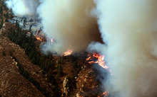 Wildfire burns through timber on the steep northeast corner of Casper Mountain on Monday, Sept. 10, 2012 in Casper, Wyo. The fire spread rapidly eastward Monday morning and had burned about 10,000 acres by 1 p.m. (AP Photo/Star-Tribune, Alan Rogers)
