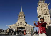 Rick Egan  | The Salt Lake Tribune   A man plays the flute, outside the
