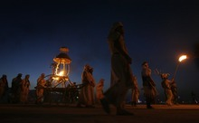 Rick Egan  | The Salt Lake Tribune   The Lamplighters procession marches along the Promenade, towards the Burning Man, carrying the cauldron with the flame that will start the festivities at Burning Man 2012, in the Black Rock Desert, NV, September 1, 2012.