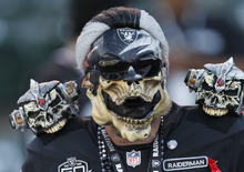 An Oakland Raiders fan is shown before an NFL football game between the Oakland Raiders and the San Diego Chargers in Oakland, Calif., Monday, Sept. 10, 2012. (AP Photo/Tony Avelar)