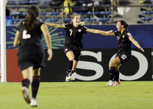 Kealia Ohai of United States ,center, celebrates with Vanessa Di Bernardo (10) after she scored a goal during final match of the U20  Women's World Cup against Germany in Tokyo, Saturday, Sept. 8, 2012. (AP Photo/Koji Sasahara)