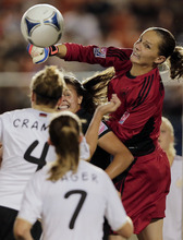 Germany's goalkeeper Laura Benkarth, right, and Katie Stengel, second right, of the U.S.,  battle for the ball as Germany's Jennifer Cramer (4) and Annabel Jaeger (7) look on during their final soccer match of the under-20 women's World Cup in Tokyo, Saturday, Sept. 8, 2012.(AP Photo/Itsuo Inouye)