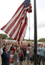 Al Hartmann  |  The Salt Lake Tribune Hundreds of students gather to raise the American flag in a Sunrise Salute to Patriots at South Jordan Middle School on Tuesday. Students sang a number of patriotic songs as they  gathered around the flag pole in a tribute to 9/11 victims.