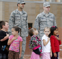 Al Hartmann  |  The Salt Lake Tribune Wasatch Elementary students stand with military personnel from Hill Air Force Base during a flag ceremony in Clearfield on Tuesday. An American flag that has flown over the USS Arizona at Pearl Harbor, Hill Air Force Base and the U.S. Capitol was presented to the school.