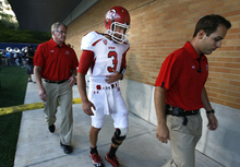 Utah quarterback Jordan Wynn heads to the locker room before halftime after he injured his left shoulder on a sack late in the second quarter against Utah State during an NCAA college football game Friday, Sept. 7, 2012, in Logan. (AP Photo/The Salt Lake Tribune, Scott Sommerdorf)