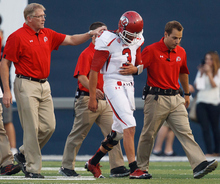 An injured Jordan Wynn leaves the field during the second quarter against Utah State on Friday, Sept. 7, 2012, in Logan, Utah. (AP Photo/The Salt Lake Tribune, Trent Nelson)
