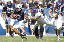 Chris Detrick  |  The Salt Lake Tribune Brigham Young Cougars wide receiver Cody Hoffman (2) runs the ball past Weber State Wildcats linebacker Anthony Morales (44) during the first half of the game against Weber State at LaVell Edwards Stadium Saturday September 8, 2012. BYU won the game, 45-13.
