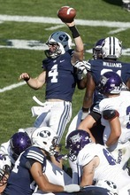 Chris Detrick  |  The Salt Lake Tribune Brigham Young Cougars quarterback Taysom Hill (4) celebrates after scoring a touchdown during the second half of the game against Weber State at LaVell Edwards Stadium Saturday September 8, 2012. BYU won the game 45-13.