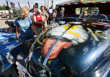 Steve Griffin | The Salt Lake Tribune Julie Vinnedge, mother of Lance Cpl. Phillip David Vinnedge, who died while serving in Afghanistan, gives people a tour of a vintage truck she, and her husband Dave Vinnedge, restored in honor of their son during an event at Fairbourne Station Plaza, in West Valley City, Utah Tuesday September 11, 2012. The Vinnedge's fulfilled his dream of restoring a 1951 Chevy truck complete with murals honoring him, his family, his military colleagues and those lost on September 11, 2001. Lance Cpl. Vinnedge's parents now travel and display the truck in memory of their son. They will be in Camp Pendleton Sept. 13, 2012 to show the truck to his son's platoon. Phillip was deployed with the 3rd Battalion, 5th Marine Regiment to Afghanistan and on October 13, 2010 Phillip was driving the lead vehicle on a security patrol with Lcpl Victor Dew, Lcpl Joe Rodewald and Cpl Justin Cain when a large IED was remotely detonated killing all 4 instantly. The four soldiers are painted on the driver side door pictured here.