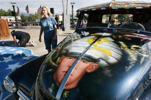 Steve Griffin | The Salt Lake Tribune   Julie Vinnedge, mother of Lance Corporal Phillip David Vinnedge, who died while serving in Afghanistan, gives people a tour of a vintage truck she, and her husband Dave Vinnedge, restored in honor of their son during an event at Fairbourne Station Plaza, in West Valley City, Utah Tuesday September 11, 2012. The Vinnedge's fulfilled his dream of restoring a 1951 Chevy truck complete with murals honoring him, his family, his military colleagues and those lost on September 11, 2001. Lance Cpl. Vinnedge's parents now travel and display the truck in memory of their son. They will be in Camp Pendleton Sept. 13, 2012 to show the truck to his son's platoon. Phillip was deployed with the 3rd Battalion, 5th Marine Regiment to Afghanistan and on October 13, 2010 Phillip was driving the lead vehicle on a security patrol with Lcpl Victor Dew, Lcpl Joe Rodewald and Cpl Justin Cain when a large IED was remotely detonated killing all 4 instantly. The four soldiers are painted on the driver side door pictured here.