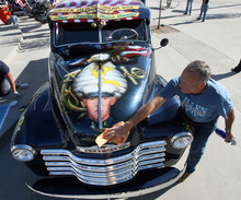 Steve Griffin | The Salt Lake Tribune   Dave Vinnedge, father of Lance Corporal Phillip David Vinnedge, who died while serving in Afghanistan, polishes the vintage truck he, and his wife, Julie Vinnedge, restored in honor of their son during an event at Fairbourne Station Plaza, in West Valley City, Utah Tuesday September 11, 2012. The Vinnedge's fulfilled his dream of restoring a 1951 Chevy truck complete with murals honoring him, his family, his military colleagues and those lost on September 11, 2001. Lance Cpl. Vinnedge's parents now travel and display the truck in memory of their son. They will be in Camp Pendleton Sept. 13, 2012 to show the truck to his son's platoon. Phillip was deployed with the 3rd Battalion, 5th Marine Regiment to Afghanistan and on October 13, 2010 Phillip was driving the lead vehicle on a security patrol with Lcpl Victor Dew, Lcpl Joe Rodewald and Cpl Justin Cain when a large IED was remotely detonated killing all 4 instantly.