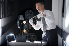 In this undated photo released by Britain's National Media Museum, Michael Harvey, curator of cinematography at the National Media Museum, Bradford, is depicted with a colour projector, as some of the earliest colour moving pictures ever made have been rediscovered after more than 100 years. The footage, made by cinematic pioneer Edward Turner in around 1901, was found in the archives of the National Media Museum in Bradford and with the help of experts at the BFI National Archive was transformed into watchable digital files. (AP Photo/ National Media Museum)